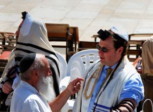For the Bar-Mitzvah at the Western Wall, the Elder Passes On Tradition to the Younger