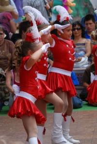 Beautiful ladies dancing at the County Fair.